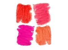 La texture du rouge à lèvres de différentes couleurs d'isolement sur le petit morceau Image libre de droits