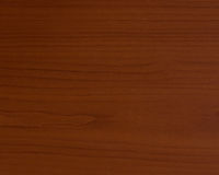 La texture en bois avec les lignes onduleuses lambrissent le brun foncé images stock