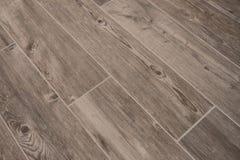La texture en bois a couvert de tuiles le plancher - grès en bois photos libres de droits