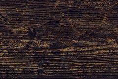 La texture en bois foncée de fond des conseils en bois naturels a souillé W Photographie stock