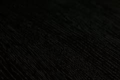La texture en bois foncée Le fond Le dessus Images stock