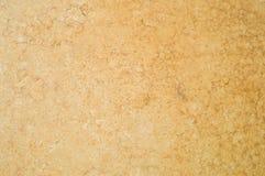 La texture est beige, brun, le revêtement mural est structure douce et hétérogène, plâtre, couvert de peinture Conception décorat photos stock