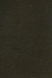La texture garnie en cuir kaki foncée peut être employée comme fond Image stock