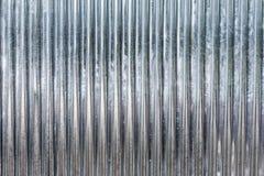 La texture ondulée en métal de zinc peut être employée comme fond image stock