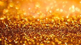 La texture ou le scintillement légère de bokeh d'or allume le backgrou de fête d'or photographie stock