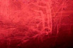 La texture rouge grunge/vintage de fond a donné au mur une consistance rugueuse dans l'obscurité Photo stock