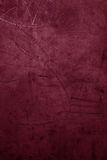 La texture/vintage pourpres foncés de fond a donné au mur une consistance rugueuse dans dar Images libres de droits