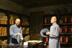 La tienda antigua del té de China, figura de cera interior de tienda del té de China, arte de la cultura de China Fotos de archivo libres de regalías