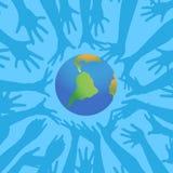 La tierra con las viga-manos, un vector Foto de archivo