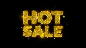 La tipografía caliente de la venta escrita con las partículas de oro chispea los fuegos artificiales
