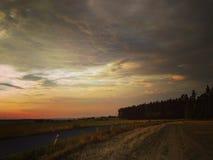 La tormenta está viniendo con la puesta del sol /2 Foto de archivo libre de regalías