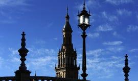 Siluette della plaza de Espana (quadrato) della Spagna, Siviglia, Spai fotografie stock libere da diritti