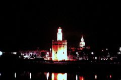 LA TORRE DEL ORO THE GOLD TOWER BY NIGHT IN SEVILLE, SPAIN Stock Photography