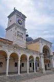 La torre di orologio nel quadrato di libertà a Udine Fotografia Stock Libera da Diritti