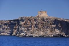 La torre di St Mary sull'isola di Comino, Malta Immagini Stock Libere da Diritti