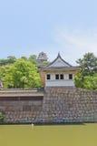 La torre y la tubería del reloj guardan del castillo de Marugame, Japón Imagen de archivo