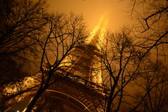 La Tour Effel. Misty Eiffel Tower with trees Royalty Free Stock Image