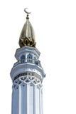 La tour gauche (minaret) de la mosquée dans un jour ensoleillé sur un fond blanc Photos stock