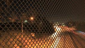 La traffic lights through fence stock video
