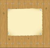 La trame du papier a goupillé aux planches en bois Photo stock