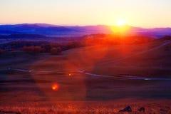 La trayectoria en la puesta del sol del prado Fotos de archivo libres de regalías
