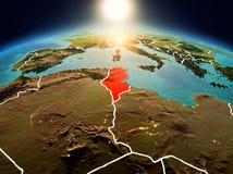 La Tunisie dans le lever de soleil de l'orbite Image libre de droits