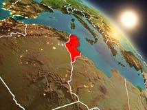 La Tunisie de l'espace pendant le lever de soleil Photo stock