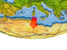 La Tunisie en rouge sur le modèle de la terre Images stock