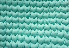 La turquoise de coton de plan rapproché tricotent l'atmosphère de couverture, chaude et confortable Tricotez le fond image libre de droits
