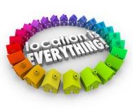 La ubicación es todo los hogares de Real Estate de las casas de las palabras 3d Fotos de archivo libres de regalías