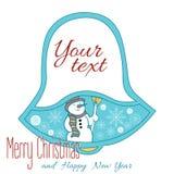 La una Navidad Bell aislada en fondo azul con el muñeco de nieve Fotografía de archivo