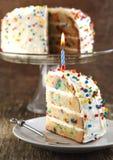 La vainilla asperja la torta Fotos de archivo