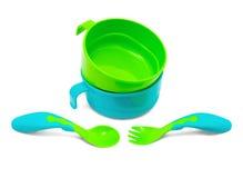 La vaisselle en plastique des enfants Photos libres de droits