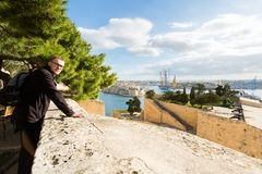 La Valetta capital city Malta. Tourist on Upper Barraka Gardens and beautiful sandstone architecture cistyscape of La Valetta capital city of Malta island Royalty Free Stock Photography