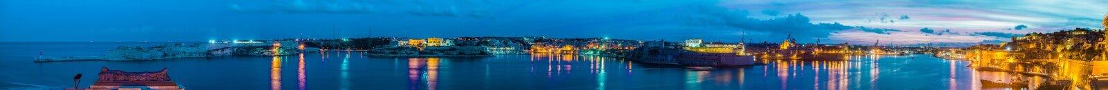 La Valletta Grand Harbour, Malta. Sunset on La Valletta Grand Harbour as seen from Lower Baracca Gardens, Malta Stock Photo
