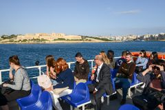 People traveling on the ferry leading to La Valletta. La Valletta, Malta - 31 October 2017: people traveling on the ferry leading to La Valletta on Malta Stock Photography