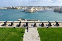 View of Vittoriosa from La Valletta on Malta. La Valletta, Malta - 31 October 2017: people visiting on walking barrakka garden at La Valletta on Malta Stock Images