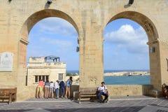 View of Vittoriosa from La Valletta on Malta. La Valletta, Malta - 31 October 2017: people visiting on walking barrakka garden at La Valletta on Malta Stock Photography
