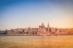 La Valletta at sunset from the sea - Capital of Malta Stock Images
