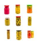 La variedad conservó la colección de cristal del pote de las verduras aislada en blanco Foto de archivo