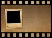 La vecchia carta fa scorrere per le foto su fondo arrugginito Fotografia Stock Libera da Diritti
