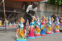 La vecchia conduttura dipinge la statua di Lord Krishna Fotografie Stock Libere da Diritti