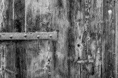 La vecchia struttura di legno rustica con le parti di metallo, perfeziona per un fondo fotografia stock libera da diritti