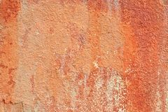La vecchia terracotta astratta ha intonacato il fondo rosso di struttura della parete Immagini Stock Libere da Diritti