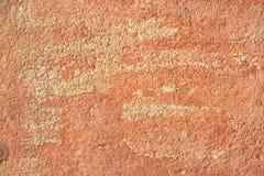 La vecchia terracotta astratta ha intonacato il fondo rosso di struttura della parete Fotografia Stock Libera da Diritti
