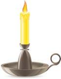 La vela de Conflagrant está en una palmatoria Foto de archivo libre de regalías