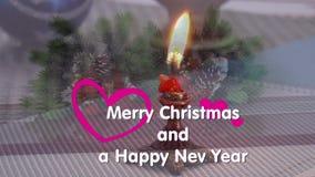 La vela, decoraciones de la Navidad, firmó con el Año Nuevo y la Navidad almacen de metraje de vídeo