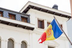 La Vella, Andorra. A Flag of Andorra hanging out in a street. Of the city center stock photo