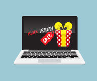La vendita di Black Friday annuncia sul computer portatile Fotografia Stock
