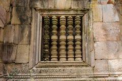 La ventana de piedra antigua de la barra de Phanom sonó el templo hindú en la provincia de Buriram, Tailandia Imagenes de archivo